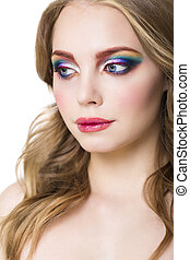Portrait of a beautiful young blond model with bright make up