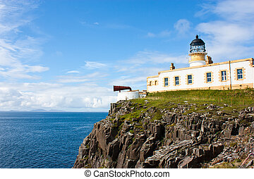 Lighthouse in Sutherland, Scotland, close to cliffs