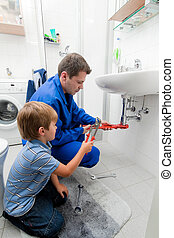 Plumbing repair sink in bathroom