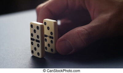 Man set up the domino with hand. Domino effect 4K