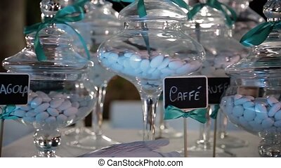 Served tables with wine glasses, white tablecloth and wooden chairs of wedding arrangement in sunlight, Italy. Italian wedding preparations.