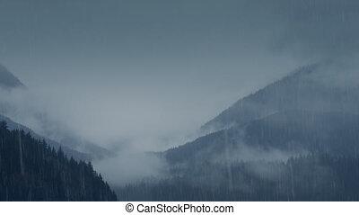 Misty Mountains In Heavy Rain - Wide shot of mountain...