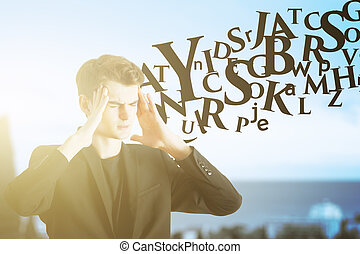Pensive man with abstract letters