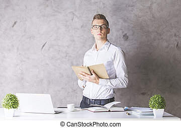 Attractive man with notepad