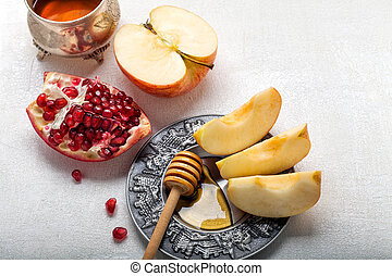 Apples, pomegranate and honey for Rosh Hashanah.