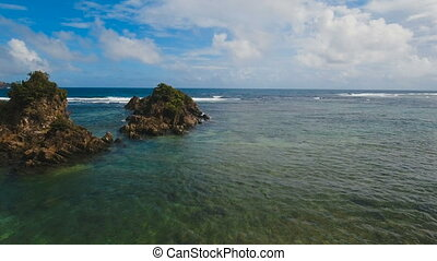 Seascape with rocks and waves. Catanduanes, Philippines. -...