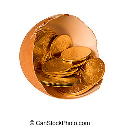 Pure gold coins in egg shell illustrating savings - Isolated...