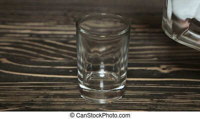 Poured a glass of vodka, close-up . Full hd video - Slow...