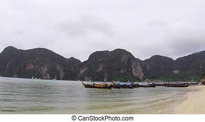 Traditional thai boat on the beach of Phi Phi island in...