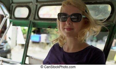 Woman in asian pickup car - Blonde woman in asian pickup car...