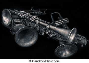 Pile of Horns (B&W) - A collection of instruments including...