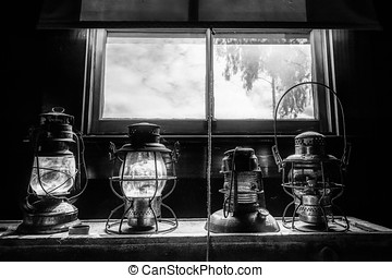 Lamps (B&W) - Railroad lanterns in an old southern...