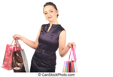 Young happy woman with shopping bags. Isolated on white background. Half-length portrait.