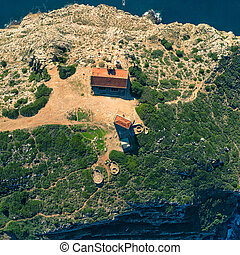 Aerial View Above Abandoned House on Cliff in Ocean,...