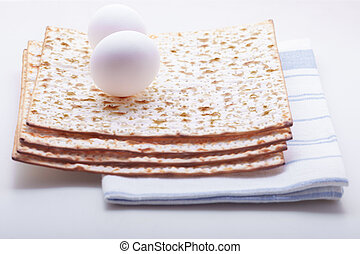 Jewish celebration passover with matza and egg.