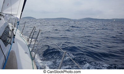 Aboard and rope white yacht on background of sea waves in...