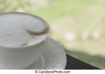 Soft focus white cup of Coffee, latte on the wooden table