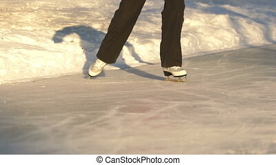 Girl riding on the ice-skating in the park. - Girl riding on...