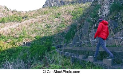 Tourists Walking on Hiking Pathway Levada Waterway, Madeira...