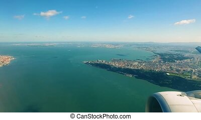 Airplane is Flying Above the Lisbon, view from the porthole