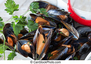 Mussels Saute - Closeup of bowl with mussels saute decorated...