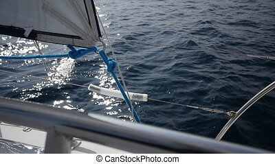 Handrail ship. Wind blows in sail on background of sky on...