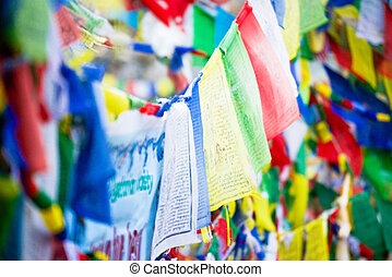color prayer flags on top of Annapurna base camp , Nepal