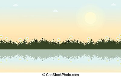 Landscape of grass with river at spring