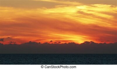 Beautiful dramatic sunset over the ocean Imsouane Morocco -...