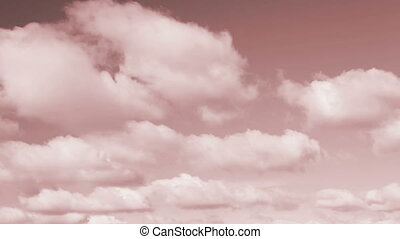 Red Tone Sky and Clouds Loop - Fluffy clouds move across the...