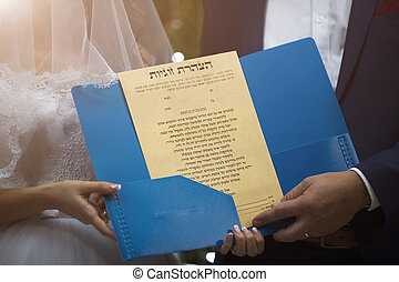 Ketubah - a prenuptial agreement in the Jewish religious...