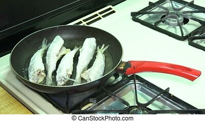 frying fish by oil in the pan, fried in frying pan with hot...