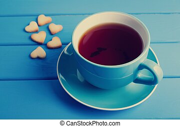 Cup of tea with cookies for Valentine's day.