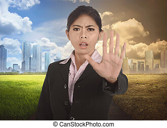 Young asian business woman with gesture to stop changing environment