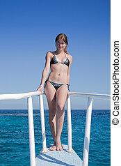 beauty woman in bikini at ship - beauty girl enjoying the...