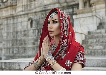 Beautiful Maharani. Young indian woman in traditional clothing with bridal makeup and oriental jewelry.