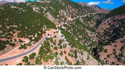 flying above serpentine road in mountains
