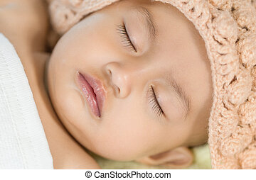 Baby sleeping on bed in the bedroom at home