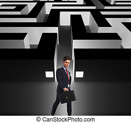 side view of a businessman walking by a maze - side view of...