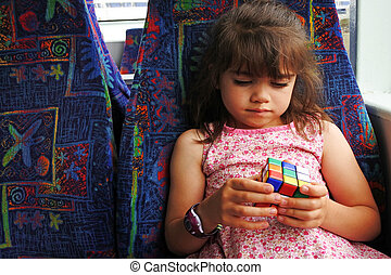 Young girl plays with Rubik's Cube - AUCKLAND - DEC 12...