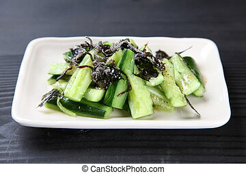 cucumber with salt kelp - close up shot of cucumber with...