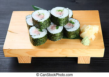tuna with green onion roll - studio shot of tuna with green...