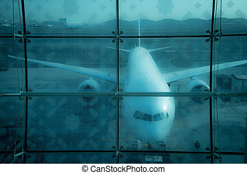 Airplane behind glass at the airport