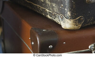 Two old suitcases, lie on the shelf. Close-up. - Two old...