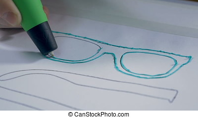 Printing with Plastic Wire Filament. 3D pen in work.