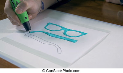 3D pen making real glasses with plastic. Innovative production technology in work.