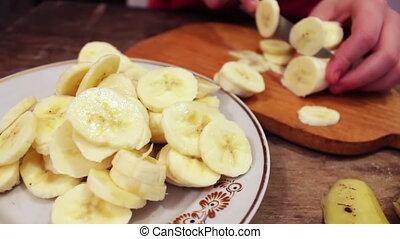 Slicing a banana into thin slices