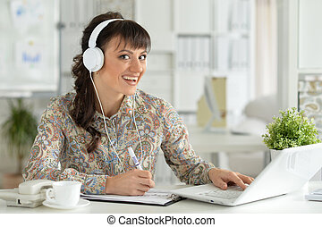 Young businesswoman with headphones