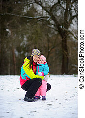 The young woman with the little daughter on walk in the...