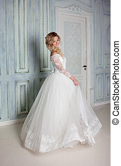 Portrait of charming woman in wedding dress. Dancing on the...